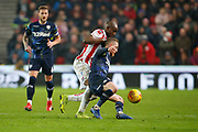 Leeds United midfielder Adam Forshaw (4) and Stoke City midfielder Oghenekaro Etebo (8) contest a loose ball  during the EFL Sky Bet Championship match between Stoke City and Leeds United at the Bet365 Stadium, Stoke-on-Trent, England on 19 January 2019.