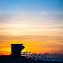 Pensacola Beach Florida lifeguard tower four sunrise photo in blue and orange. Pensacola Beach is a coastal city on the Florida Panhandle in Northwest Florida in the  United States of America. Photo is high resolution. Copyright ⓒ 2018 Paul Velgos with All Rights Reserved.