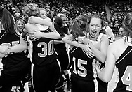 The Jackson Hole High School girls basketball team celebrates their 3A State Championship in Casper on Saturday night. Their 49-42 victory over Powell marks the fourth year in a row the Broncs have earned the state title.