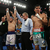 KISSIMMEE, FL - MARCH 06:  Jonathan Oquendo (L) celebrates his victory against Gabino Cota for the WBO Latino Flyweight Title belt during the Telemundo Boxeo boxing match at the Kissimmee Civic Center on March 6, 2015 in Kissimmee, Florida. Oquendo won the belt after a 10 round unanimous decision on the scorecards. (Photo by Alex Menendez/Getty Images) *** Local Caption *** Jonathan Oquendo; Gabino Cota