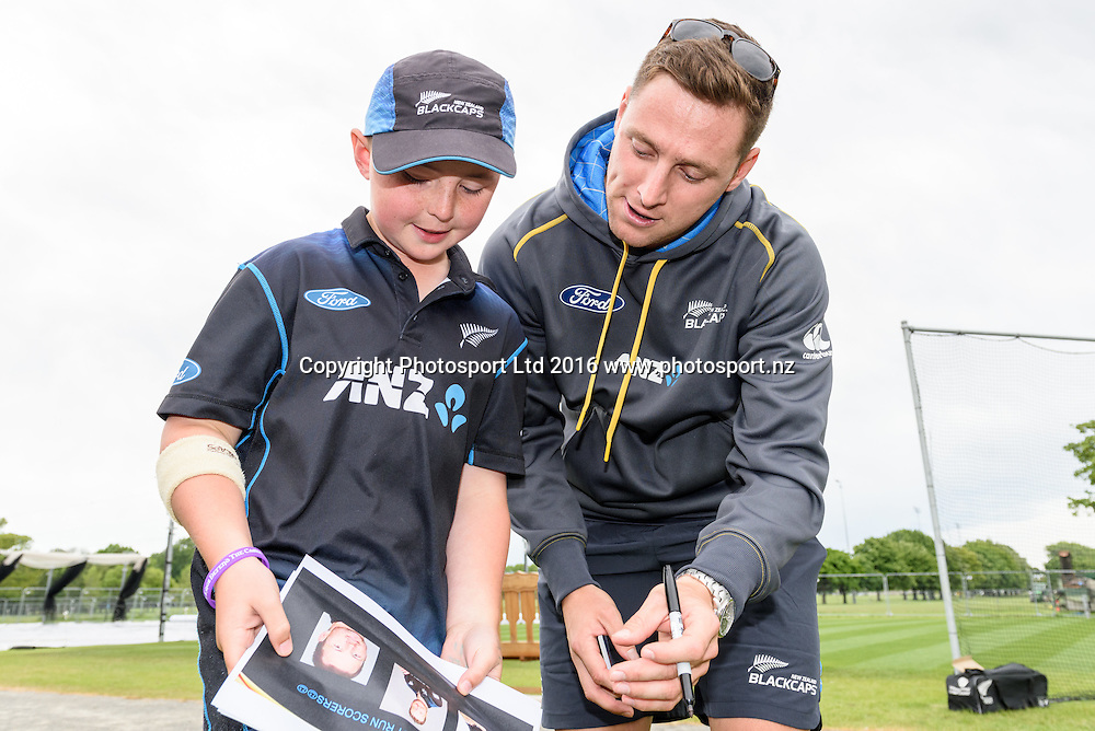 Matt Henry of the Blackcaps interacts with a young fan during a Blackcaps Barbecue at Hagley Oval in Christchurch, New Zealand. 14 November 2016. Photo: Kai Schwoerer / www.photosport.nz