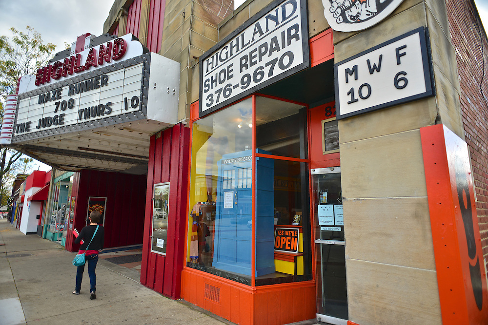 Street view of Highland Shoe Repair and the Highland Theatre.