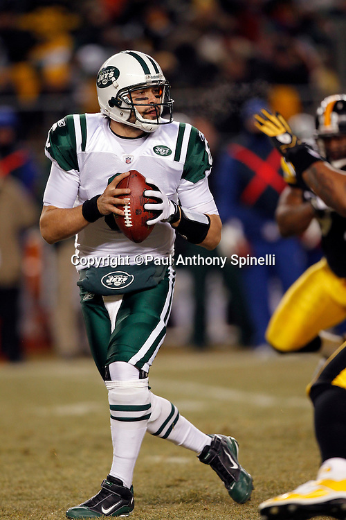 New York Jets quarterback Mark Sanchez (6) drops back and throws a first quarter pass during the NFL 2011 AFC Championship playoff football game against the Pittsburgh Steelers on Sunday, January 23, 2011 in Pittsburgh, Pennsylvania. The Steelers won the game 24-19. (©Paul Anthony Spinelli)