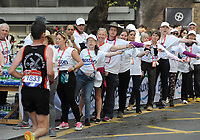 Athletics - 2018 Virgin Money London Marathon<br /> <br /> Runners are offered water along the route<br /> <br /> COLORSPORT/ANDREW COWIE