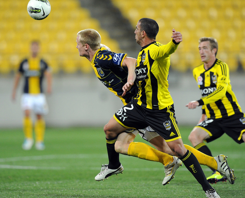 Phoenix's Manny Muscat, right, tacklesCentral Coast Mariners Matthew Simon in the A-League football match at Westpac Stadium, Wellington, New Zealand, Friday, November 04, 2011. (AAP Images/SNPA, Ross Setford)