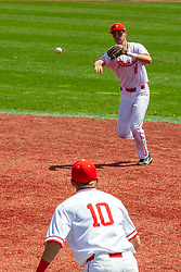 NORMAL, IL - May 01:  Derek Parola fields a grounder in the infield and tosses to Jack Butler at first during a college baseball game between the ISU Redbirds and the Indiana State Sycamores on May 01 2019 at Duffy Bass Field in Normal, IL. (Photo by Alan Look)