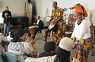 Middletown, New York  - A dancer tries to get a member of the audience to participate as Maxwell Kofi Donkor and the Sankofa Drum and Dance Ensemble perform at Thrall Library on Feb. 26, 2012.