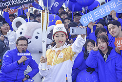November 1, 2017 - Incheon, South Korea - Nov 1,2017-Incheon, South Korea-South Korean speed skater Lee Sang-hwa carry the torch with run for the 2018 PyeongChang Winter Olympics on Incheon Bridge in Incheon on Nov. 1, 2017. South Korean speed skating star Lee Sang-hwa realized her dream of running in an Olympic torch relay on Wednesday, carrying the flame for next year's Winter Games on home ice. Lee, two-time reigning Olympic gold medalist in the women's 500m, ran as the 60th torchbearer for the 2018 PyeongChang Winter Games. The Olympic flame arrived at Incheon International Airport earlier Wednesday, having been lit and handed over to PyeongChang in Greece, and the torch relay got underway on Incheon Bridge, near the airport. (Credit Image: © Zuma via ZUMA Wire)