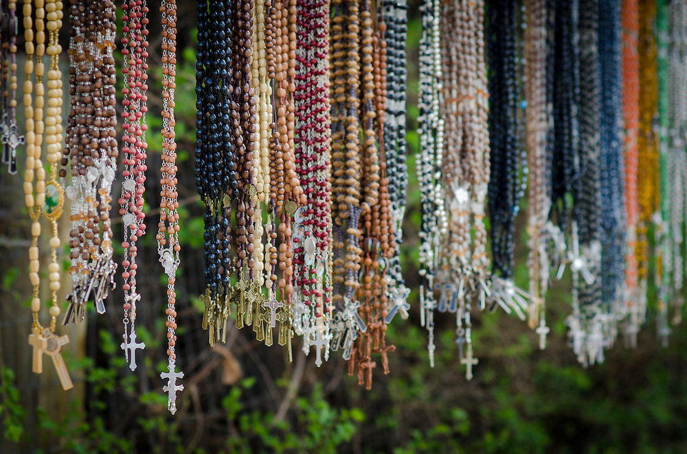 Rosaries hang for sale outside of El Santuario de Chimayo during Holy Week, Friday, April 18, 2014. Many pilgrims carry rosaries and crosses to pray for and honor loved ones. (AP Photo/Jeremy Wade Shockley)