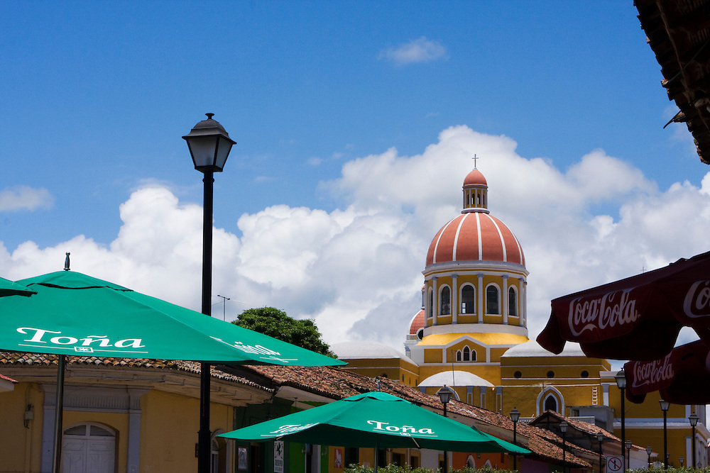 The Cathedral of Granada viewed form the recently renovated Calle La Calzada. Granada is Nicaragua's most famous city. founded in 1524 it is one of best examples of Spanish colonial architecture in the Americas. .it has a varied history including its almost total destruction by filibuster William Walker in a childlike tantrum. Today it is a popular tourist town though retains a strong sense of its own identity.