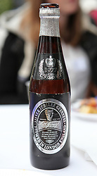 © Licensed to London News Pictures. 04/06/2012. Reading, Berkshire. A Silver Jubilee Guiness bottle makes it's debut at the Shepherds Lane Queen's Diamond Jubilee garden party. Photo credit : Rebecca Mckevitt/LNP