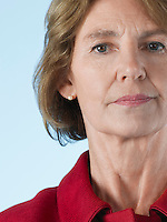 Middle-aged woman on blue background close-up