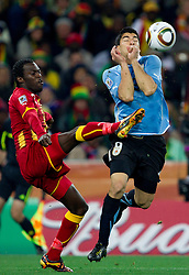 Hans Sarpei of Ghana vs Luis Suarez of Uruguay during the  2010 FIFA World Cup South Africa Quarter Finals football match between Uruguay and Ghana on July 02, 2010 at Soccer City Stadium in Sowetto, suburb of Johannesburg. Uruguay defeated Ghana after penalty shots. (Photo by Vid Ponikvar / Sportida)