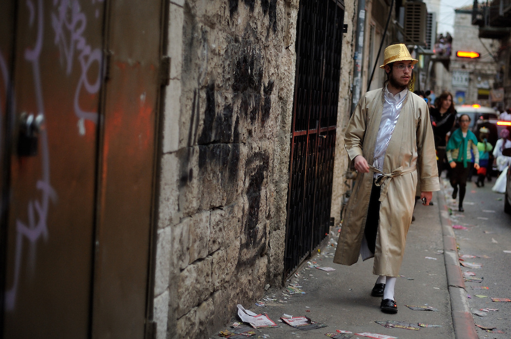JERUSALEM, ISRAEL - MARCH 17, 2014: An Ultra-Orthodox Jewish man wearing a costume during Purim holiday in the ultra-orthodox Mea Shearim neighborhood in Jerusalem on March 17, 2014. The festival of Purim commemorates the rescue of Jews from a genocide in ancient Persia. Photo by Gili Yaari