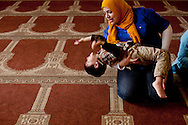 Drost Kokoye plays with her friend's son before a Kurdish-language service at the Salahadeen Center in Nashville, Tennessee on Friday, February 3, 2012. Her father and some of his friends started the mosque a decade ago as a place for Kurds to worship in their own language.