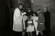 baptising of a baby with family 1960s Holland