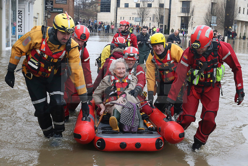 © London News Pictures. 28/12/2015. York, UK. 87 year old Betty Charlton is rescued from her flooded home where she has been stranded since Saturday without heating in York, northern England. Photo credit: LNP