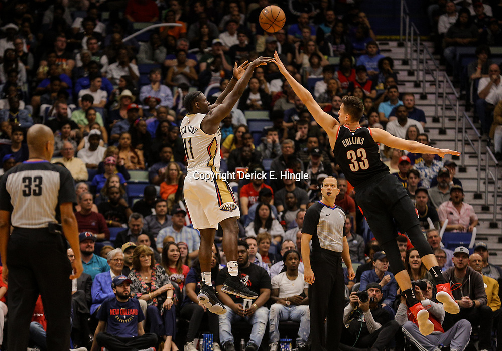 Mar 27, 2018; New Orleans, LA, USA; New Orleans Pelicans guard Jrue Holiday (11) shoots over Portland Trail Blazers center Zach Collins (33) during the second half at the Smoothie King Center. The Trail Blazers defeated the Pelicans 107-103. Mandatory Credit: Derick E. Hingle-USA TODAY Sports