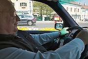 Vienna. Iouli Andreev, former Chief Liquidator during the Chernobyl nuclear catastrophe. Lives in Vienna with his wife, cat and one remaining lung. Here he enjoys driving his Mercedes-Benz.