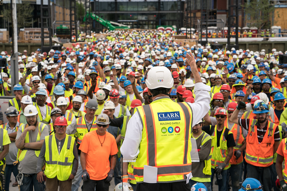 Construction workers during a stand down and talk on OSHA on site at the Wharf in Washington DC. May 1, 2017.