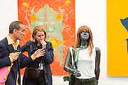 "New York, NY - 6 May 2016. Frieze New York art fair. A man and a woman examine one of a pair of sculptures, titled ""Les guérillieres"", by Mai-Thu Perret in the David Kordansky Gallery."