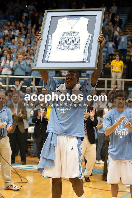 29 November 2009: North Carolina Tar Heels forward Deon Thompson (21) celebrates the 600th career win for head coach Roy Williams after a 73-80 win over the Nevada Wolfpack at the Dean Smith Center in Chapel Hill, NC.