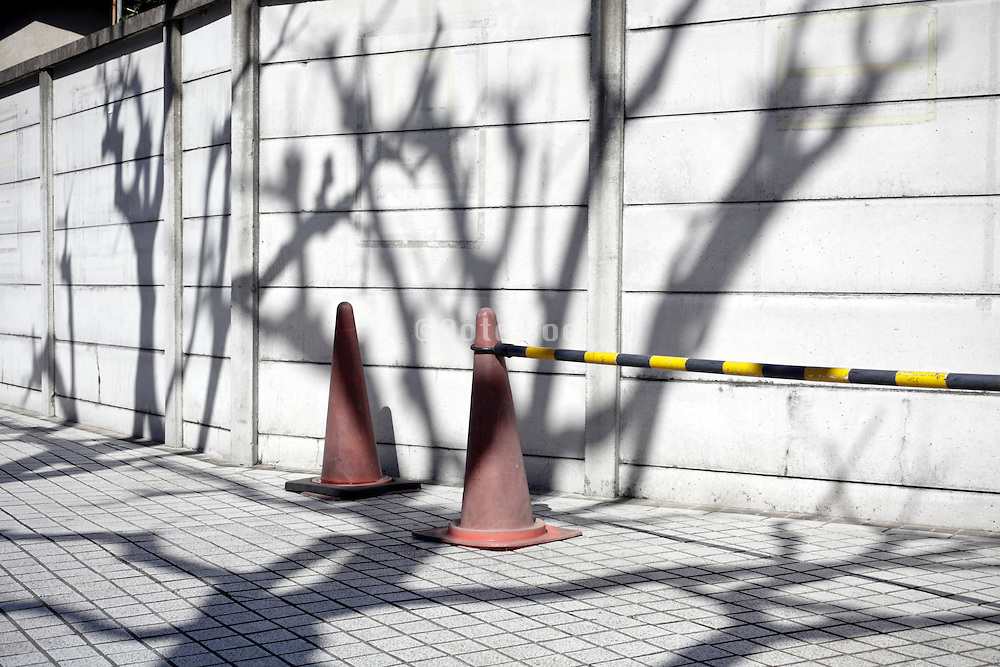 cones with bar blocking part of a pedestrian walkway