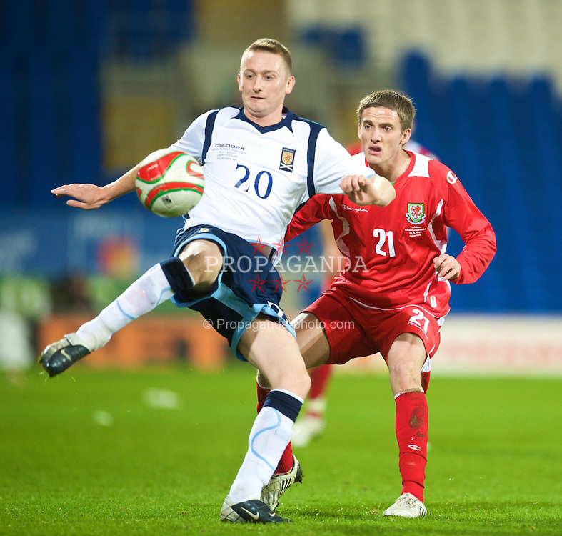 CARDIFF, WALES - Saturday, November 14, 2009: Wales' Andy King and Scotland's Derek Riordan during the international friendly match at the Cardiff City Stadium. (Pic by David Rawcliffe/Propaganda)