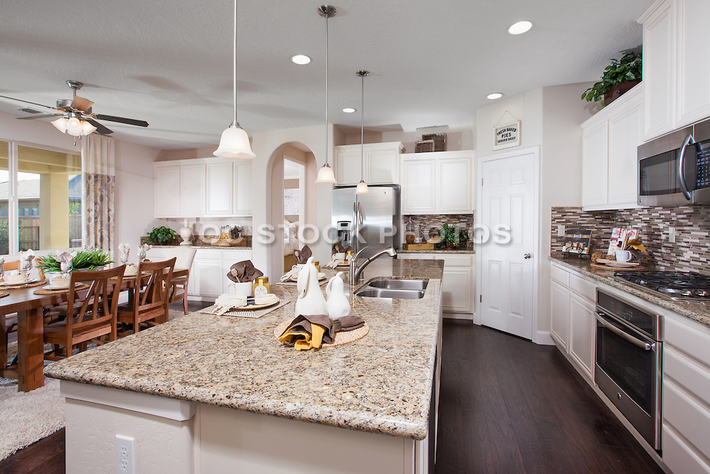 Kitchen with White Cabinets and Expresso Plank Hard Wood Floors