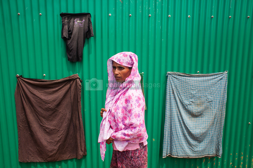 September 7, 2017 - Cox'S Bazar, Bangladesh - Rohingya ethnic minority people going at a temporary makeshift camp after crossing over from Myanmar into the Bangladesh side of the border, near Cox's Bazar's Whykkhong Lamba Bill, Thursday, Sept. 7, 2017. Tens of thousands more people have crossed by boat and on foot into Bangladesh in the last two weeks as they flee violence in western Myanmar. (Credit Image: © Ahmed Salahuddin/NurPhoto via ZUMA Press)