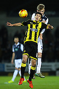 Burton Albion defender Anthony O'Connor and Millwall FC forward Aiden O'Brien challenge for the ball during the Sky Bet League 1 match between Burton Albion and Millwall at the Pirelli Stadium, Burton upon Trent, England on 1 December 2015. Photo by Aaron Lupton.