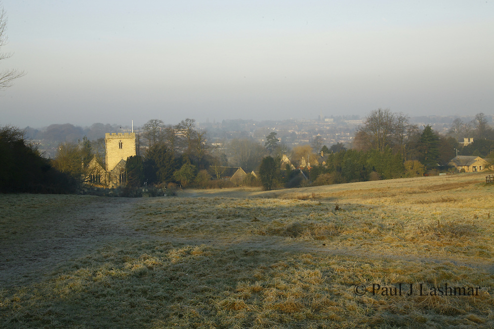 St Botophs Parish Church, Barton Seagrave Northamptonshire, seen from 'The Spinney' on a frost winter morning..looking across the valley and through the mist is Kettering