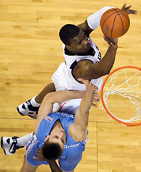 Virginia forward Jamil Tucker (12) shoots over North Carolina forward Tyler Hansbrough (50).  The the #5 ranked North Carolina Tar Heels defeated the Virginia Cavaliers 83-61 in NCAA Basketball at the John Paul Jones Arena on the Grounds of the University of Virginia in Charlottesville, VA on January 15, 2009.