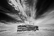 Old building and clouds<br />Grasslands National Park<br />Saskatchewan<br />Canada