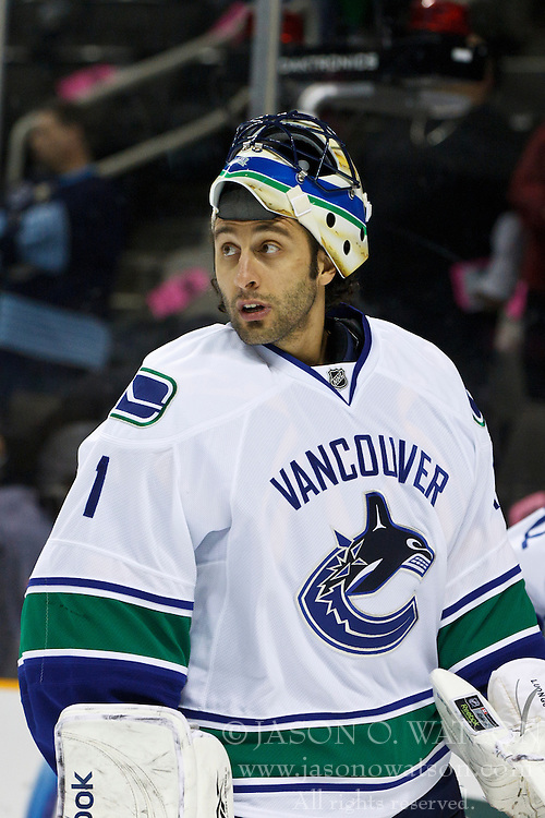 January 3, 2011; San Jose, CA, USA; Vancouver Canucks goalie Roberto Luongo (1) warms up before the game against the San Jose Sharks at HP Pavilion. Vancouver defeated San Jose 4-3. Mandatory Credit: Jason O. Watson / US PRESSWIRE