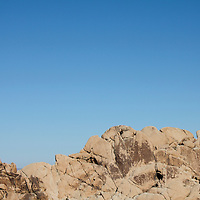 Standing on top of a mountain in Joshua Tree National Forest, California.