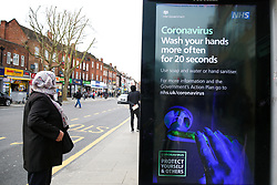 © Licensed to London News Pictures. 07/03/2020. London, UK. A woman views a Coronavirus public information campaign poster in London, which focuses on hand washing. Forty two more people have tested positive of the virus, taking the total to 206 in the UK. Photo credit: Dinendra Haria/LNP