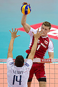 (R) Piotr Nowakowski from Poland attacks against (L) Nicolas Le Goff from France during the 2013 CEV VELUX Volleyball European Championship match between Poland and France at Ergo Arena in Gdansk on September 21, 2013.<br /> <br /> Poland, Gdansk, September 21, 2013<br /> <br /> Picture also available in RAW (NEF) or TIFF format on special request.<br /> <br /> For editorial use only. Any commercial or promotional use requires permission.<br /> <br /> Mandatory credit:<br /> Photo by &copy; Adam Nurkiewicz / Mediasport
