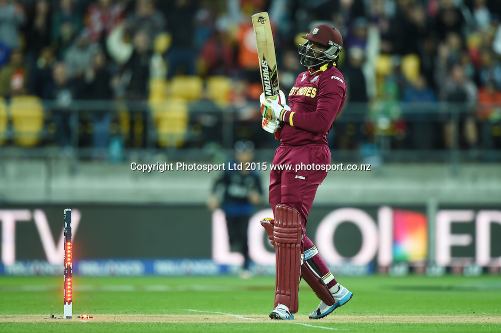 Chris Gayle is bowled during the ICC Cricket World Cup quarter final match between New Zealand Black Caps and the West Indies, Wellington, New Zealand. Saturday 21March 2015. Copyright Photo: Andrew Cornaga / www.Photosport.co.nz