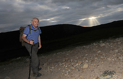 Into the light early morning pilgrim Benny Martin on his way up Croagh Patrick for the annual pilgrimage yesterday.<br />