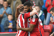 Sheffield United player Ethan Ebanks- Landell (19) scores goal to go 1-0 up  and celebrate with Sheffield United player John Fleck (4) during the EFL Sky Bet League 1 match between Sheffield Utd and Port Vale at Bramall Lane, Sheffield, England on 15 October 2016. Photo by Ian Lyall.
