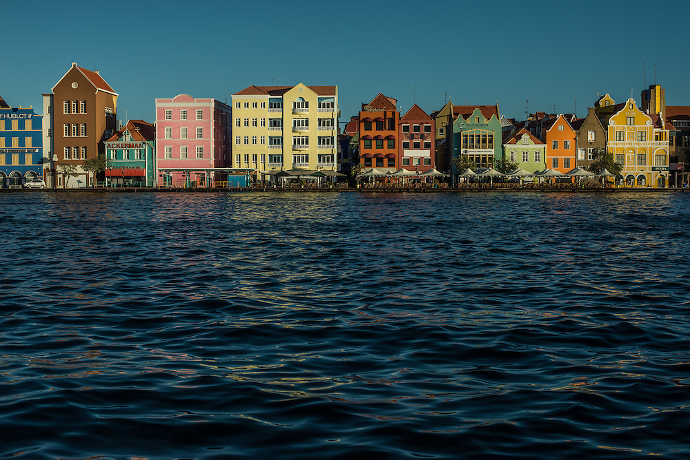 """WILLEMSTAD, CURAÇAO - OCTOBER 23, 2016: Curaçao, along with Aruba and Colombia and Brazil, are countries receiving a spike in undocumented migrants from Venezuela. The small Caribbean islands neighboring Venezuela say they simply cannot absorb the onslaught. The closest to Venezuela's coast, Aruba and Curaçao, have effectively sealed their borders to poor Venezuelans since last year by making them show $1,000 in cash before entering — the equivalent of more than five years of earnings in a minimum wage job. Both countries have increased patrols and deportations, and Aruba has even set aside a stadium to hold as many as 500 Venezuelan migrants after they are caught. It's a dramatic reversal of fortune for Venezuelans, who once went to Curaçao to spend money as tourists, not to plead for work.  But perhaps most startling are the Venezuelans now fleeing by sea, an image so symbolic of the perilous journeys to escape Cuba or Haiti — but not oil-rich Venezuela. """"It has all totally changed,"""" said Ivan de la Vega, a sociologist at the Central University of Venezuela. He added that about 160,000 Venezuelans have fled the country in the last year alone, about 60 percent more than the number who left the year before. """"The earnings of these people are low,"""" Mr. de la Vega said of the recent migrants. """"The only option left to them is the nearby countries, ones they can get to on foot, or by rafts, or go on boats with tiny motors."""" Inflation will hit a mind-boggling 1,600 percent this year, the International Monetary Fund estimates, shriveling salaries and creating a new class of poor Venezuelans who have abandoned professional careers for precarious lives abroad. PHOTO: Meridith Kohut for The New York Times"""