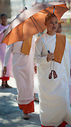 Bald Buddhist nun under umbrella (Myanmar)