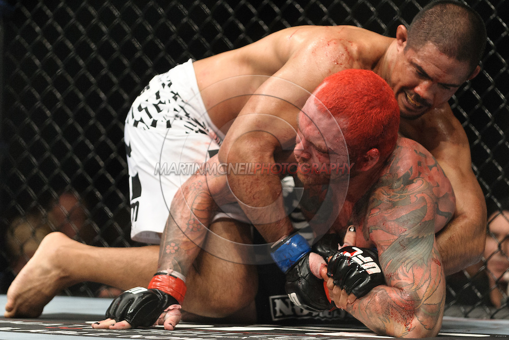 "BIRMINGHAM, ENGLAND, NOVEMBER 5, 2012: Mark Munoz (top) attempts to keep Chris Leben pinned down during ""UFC 138: Munoz vs. Leben"" inside the National Indoor Arena in Birmingham, United Kingdom"