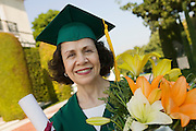 Graduate Holding Diploma and Flowers