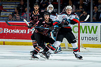 KELOWNA, BC - FEBRUARY 17: <br /> Jake Lee #21 of the Kelowna Rockets is checked by Cael Zimmerman #11 of the Calgary Hitmen  at Prospera Place on February 17, 2020 in Kelowna, Canada. (Photo by Marissa Baecker/Shoot the Breeze)