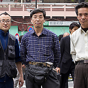 "From left -  Ken'ya Omura (?), Mikoto Chiba and Akio Hasebe of ""Chiba Special"" shoe shiners pose for a photo across from Yurakucho Station in Tokyo, Tuesday, May 08, 2012. (Albert Siegel)"
