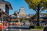 """Himeji Castle, built 1609, dominates the city of Himeji in Hyogo Prefecture, Japan. Himeji Castle is both a national treasure and a UNESCO World Heritage Site. Unlike many other Japanese castles, it was never destroyed by war, earthquake or fire and survives to this day as one of the country's twelve original castles. History: Starting as forts built in 1333 and 1346, Himeji Castle (aka White Heron Castle or White Egret Castle) was remodeled in 1561, remodeled in 1581, enlarged in 1609 to its present complex, extensively repaired in 1956, and renovated in 2009-15. Displayed inside are historic samurai armour and swords. From the upper floors, view fish-shaped roof ornaments that are believed to protect from fire. Across the moat, visit Koko-en, a pleasing reconstruction of former samurai quarters, nine Edo period homes, plus movie-set gardens. Himeji Castle starred in the 1967 James Bond movie """"You Only Live Twice""""; in Akira Kurosawa's 1980 film """"Kagemusha"""" and 1985 """"Ran""""; and in the 1980 television miniseries Shogun (portraying feudal Osaka castle). By train, Himeji is 3 hours round trip from Kyoto."""