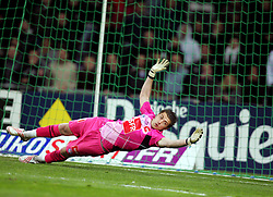 Cédric Carrasso tries to save a penalty for Toulouse during the 1/4 Final of la Coupe de France, Stade Municipal, Toulouse, France, 18th March 2009.