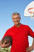 Senior man on outdoor basketball court, portrait